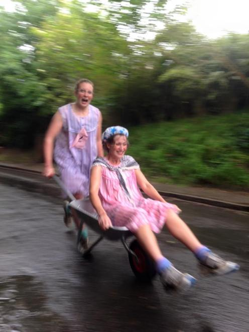 Leading the pack at the Braughing Wheelbarrow Race